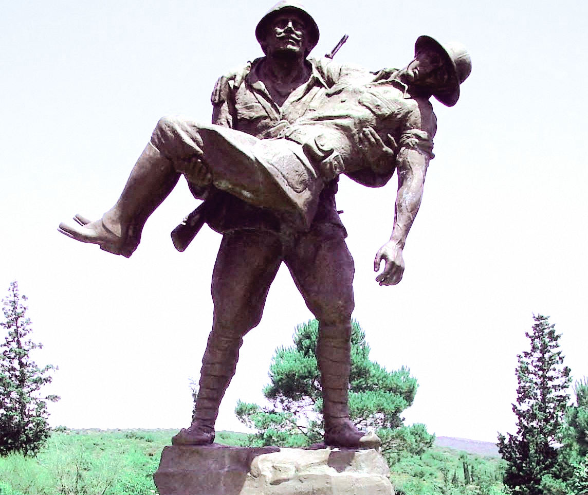 Turkish soldier carrying wounded Australian soldier